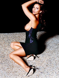 http://img152.imagevenue.com/loc505/th_006211115_charisma_carpenter_topless_playboy_shoot_04_123_505lo.jpg